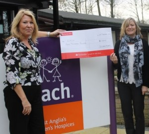 Nikki Wood (r) presenting the cheque for £1000 to Karen Newton